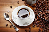 Traditional espresso cup with mocha, coffee beans and scoop on wood background. Top view - 221192034