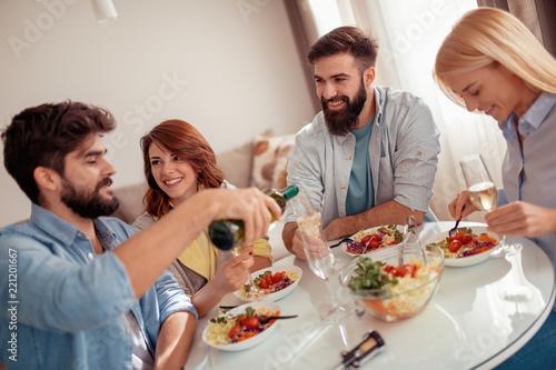 Fototapeta samoprzylepna Friends having lunch together at home