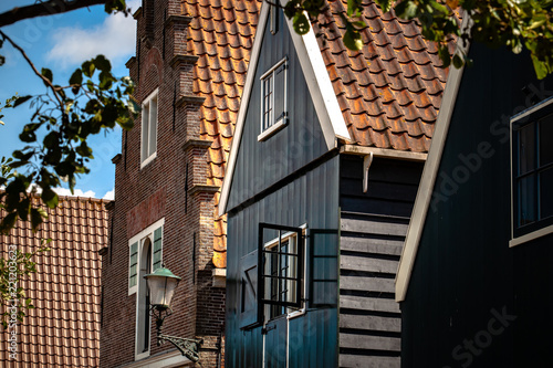 Foto Murales Traditional Dutch houses of wood built with typical architecture and painted with bright colors.