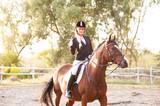 A beautiful girl rider drives a horse. Horse theme - 221203806