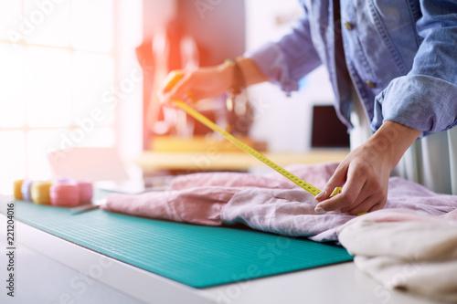 Leinwanddruck Bild Fashion designer woman working on her designs in the studio