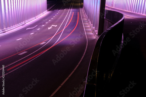 Fototapeta Viaduct in the Netherlands with driving cars and exposure lights.