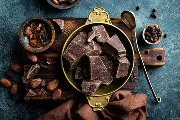 Dark chocolate pieces crushed and cocoa beans. Chocolate background © Sea Wave