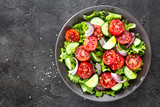 Salad. Fresh vegetable salad with tomato, cucumber, lettuce and red onion - 221223831