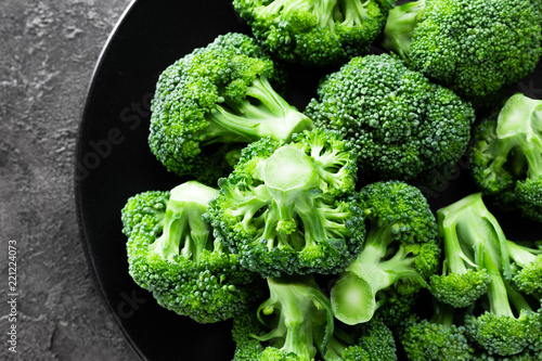 Broccoli. Fresh broccoli on plate - 221224073