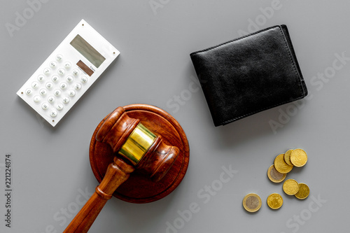 Fototapeta Financial failure, bankruptcy concept. personal bankruptcy. Judge gavel, wallet, coins, calculator on grey background top view