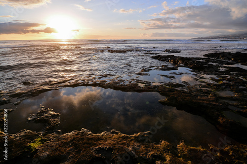 Foto Murales The Sun Setting in the Sea
