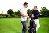Young couple enjoying time on a golf course - 221243002