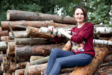 young girl having fun in the forest, posing near the logs - 221245499
