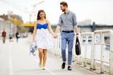 Happy couple walking outdoors - 221249400
