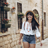 woman walking by tight streets of kotor - 221249641