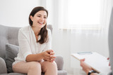 Happy young woman talking to a financial expert about a loan for a new apartment - 221253288
