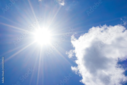Foto Murales blue sky with clouds and sun reflection.The sun shines bright in the daytime in summer