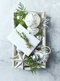 Vintage Christmas Decorations and Evergreen Twigs on a rustic wooden tray. Flatlay - 221271047