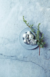 An arrangement of Christmas Balls and Evegreen Twigs on gray marble background.  Flatlay. Copy space - 221271077