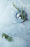 An arrangement of Christmas Balls and Evegreen Twigs on gray marble background.  Flatlay. Copy space - 221271082