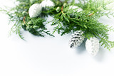 Natural Christmas decoration made from evergreen twigs and silver cones. Close-up. Copy space - 221271099