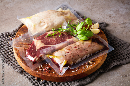 Meat vacuum sealed on stone table - 221279650