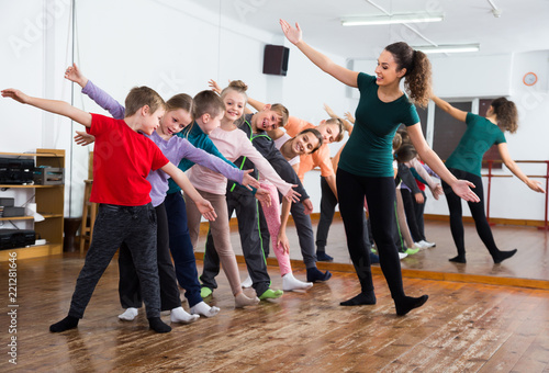 Laughing children studying contemp dance