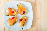 Mediterranean snack - bruschettes with salmon - 221283670
