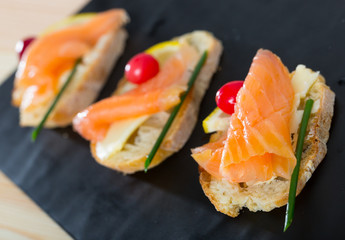 Canapes with salmon, butter and cranberries