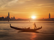 Gondola and the sunset in Venice Italy