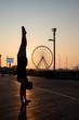 Handstands on the boardwalk by Atlantic City ferris wheel