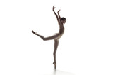 Young graceful female ballet dancer or classic ballerina dancing isolated on white studio. Caucasian model on pointe shoes - 221293401