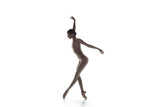 Young graceful female ballet dancer or classic ballerina dancing isolated on white studio. Caucasian model on pointe shoes - 221293498