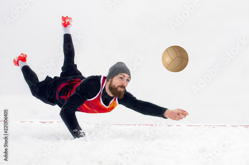 Fototapeta Man snow voleyball player isolated on white background. Snow volleyball. Winter sport