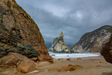 Steep beach with stormy clouds - 221318462