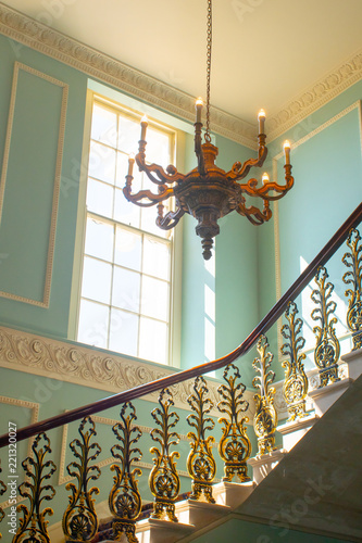 Georgian Stairway With Chandelier Hanging From The Ceiling