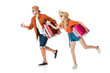 side view of shocked couple running with travel bags isolated on white