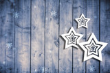 Textured wooden boards with illustrated hanging Christmas stars, copy space background.  Holiday greeting card. - 221327203