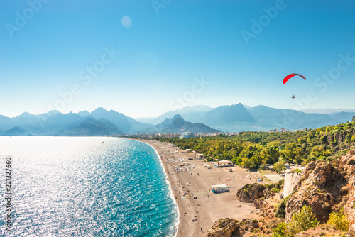 Leinwandbild Motiv Panoramic bird view of Antalya and Mediterranean seacoast and beach with a paraglider, Antalya, Turkey