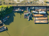 Aerial drone view, old ships and barges are on the river on the pier. - 221328037