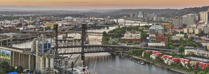 Drone aerial looking over an industrial area towards downtown Portland Oregon at sunrise © Chris Anson