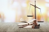 Justice Scales and books and wooden gavel on table. Justice