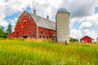An Old Barn and Silo Stand Tall on a Hill in Minnesota