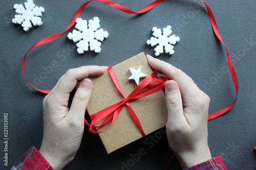 female hands opening gift box on black background copy space birthday new year