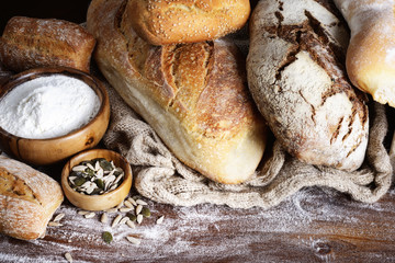 Assorted bread on wood background