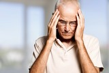 Portrait of a mature man holding his head in pain - 221357282