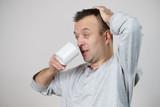 Tired man enjoying his coffee - 221359427