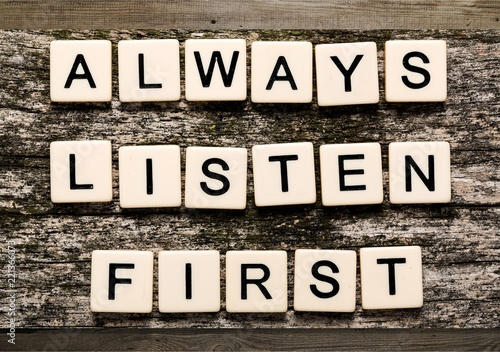 Always Listen First sign with wooden cubes