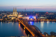Leinwanddruck Bild - Image of Cologne with Cologne Cathedral during twilight blue hour in Germany.