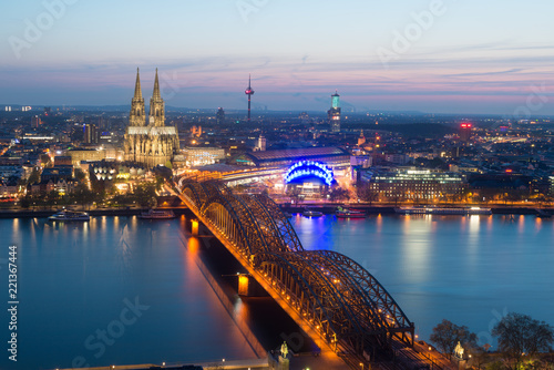 Leinwandbild Motiv Image of Cologne with Cologne Cathedral during twilight blue hour in Germany.