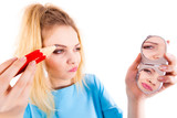 Woman painting eyebrows using regular pencil - 221367866