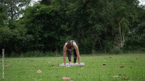Poster Beautiful woman is doing Yoga in Park