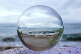 Stormy shore captured in Glass or Crystal Ball - 221372483