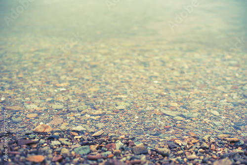 Defocus Natural abstract background of sea pebbles water . - 221373294